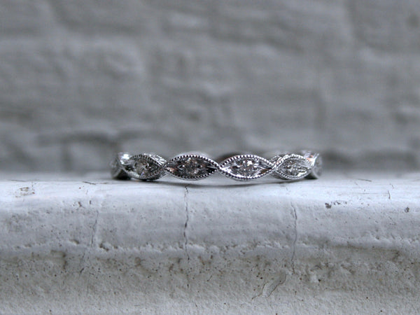 Twisted 14K White Gold Diamond Wedding Band with Engraved Sides.