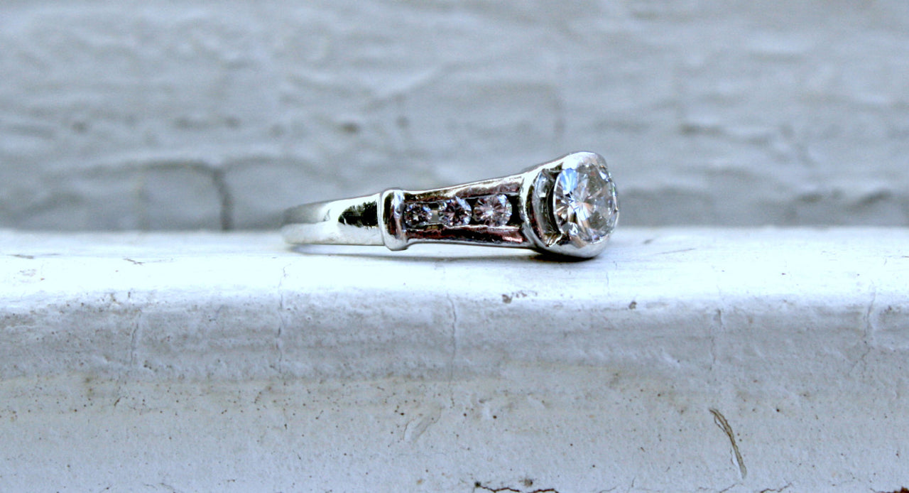 Vintage Platinum Channel Diamond Engagement Ring - 0.68ct.