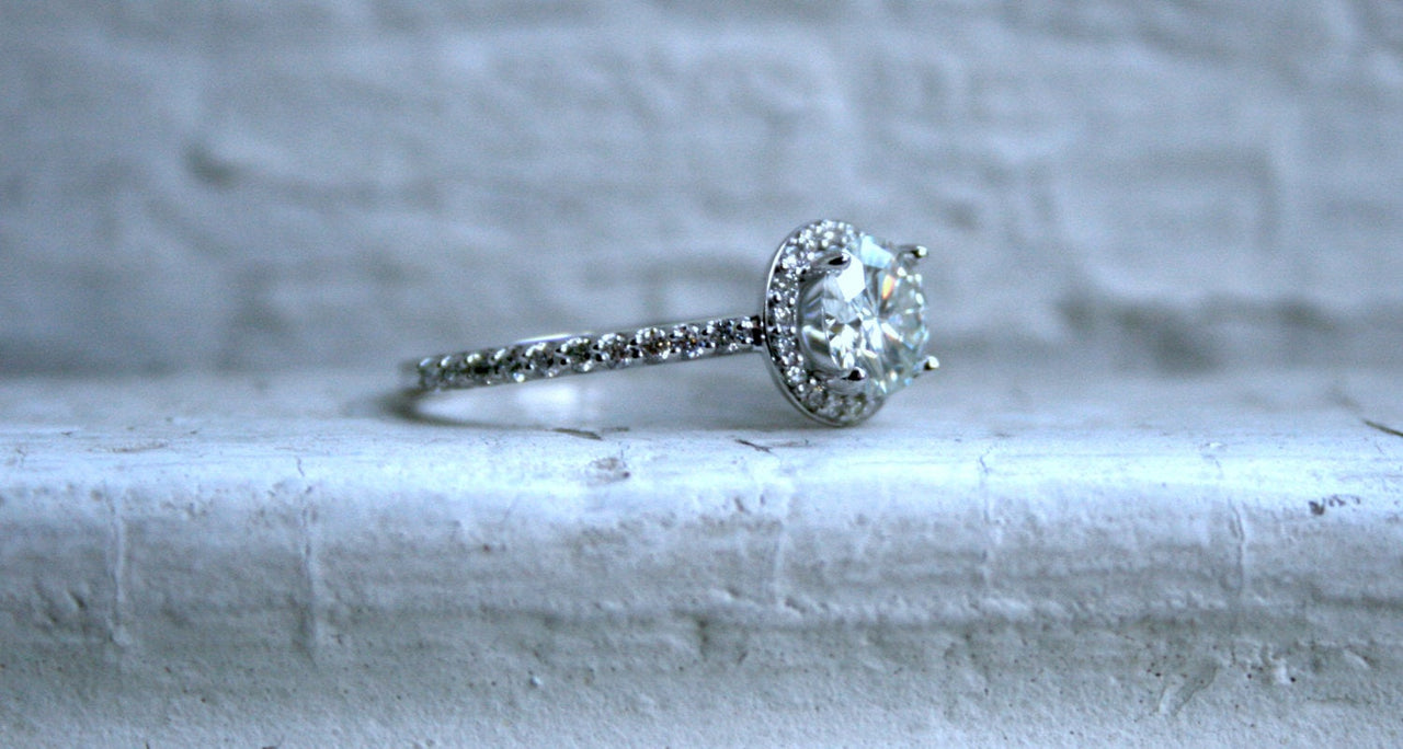 Classic Diamond Halo and Moissanite Engagement Ring in 18K White Gold - 0.67ct.