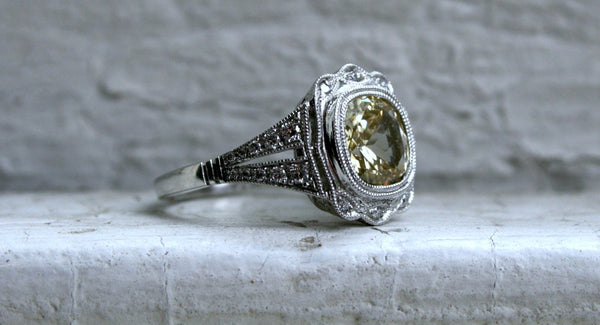 Natural Yellow Sapphire and Diamond Halo Engagement Ring in Platinum.