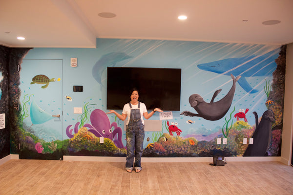 Hawaii artist Jan Tetsutani paints mural at Timbers Kauai