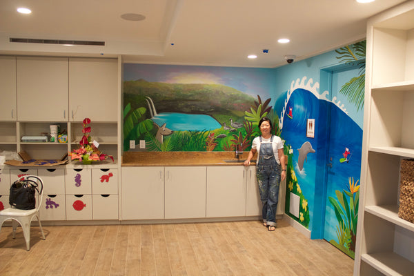 Hawaii artist Jan Tetsutani paints mural at Timbers Resorts on Kauai, Hawaii