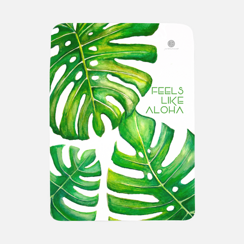 TropicalMonstera Baby Blanket made out of fleece. This soft fleece baby blanket with botanical artwork by Hawai'i artist Jan Tetsutani will help baby to feel cozy tropical Hawaiian vibes.
