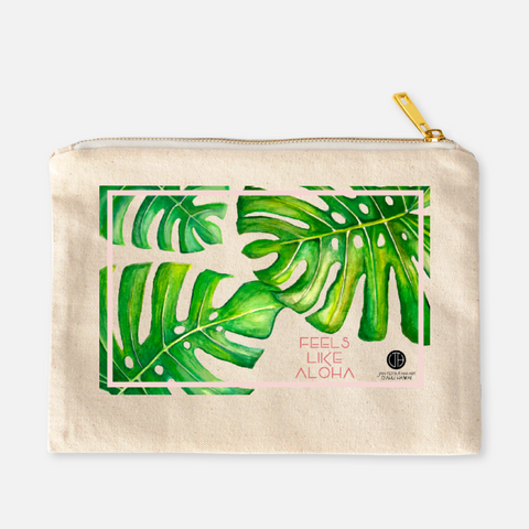 Monstera leaves cosmetic bag with zipper by Hawaii artist Jan Tetsutani. It feels like aloha. A Hawaiian print cosmetic zipper clutch for girls and women. Add this tropical print beach clutch to your 2018 Gift ideas for her.