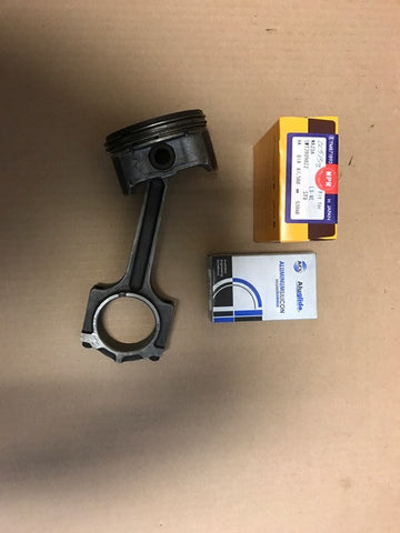 Ford/Mazda 2.3 Used piston with connecting rod with Brand new rings set and Rod bearings