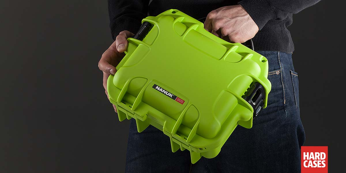 Man holding the Nanuk 905 Lime Green in hand
