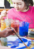 Children painting with safe sustainable art supplies.