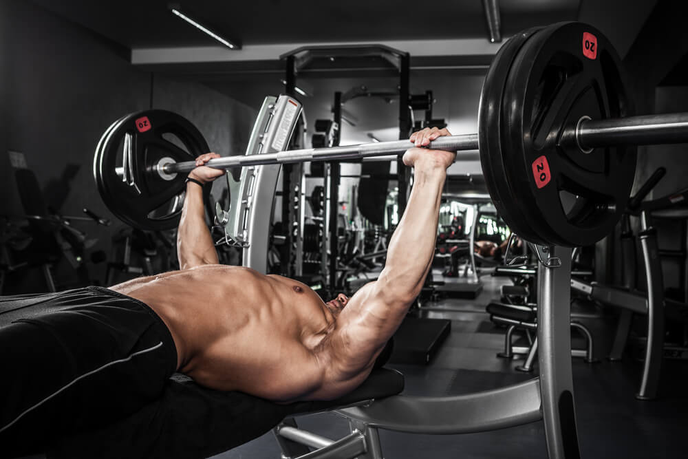 Man bench pressing heavy weights
