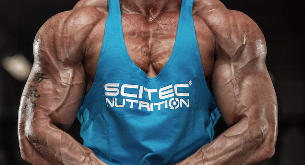 Scitec Nutrition model flexing arm muscles