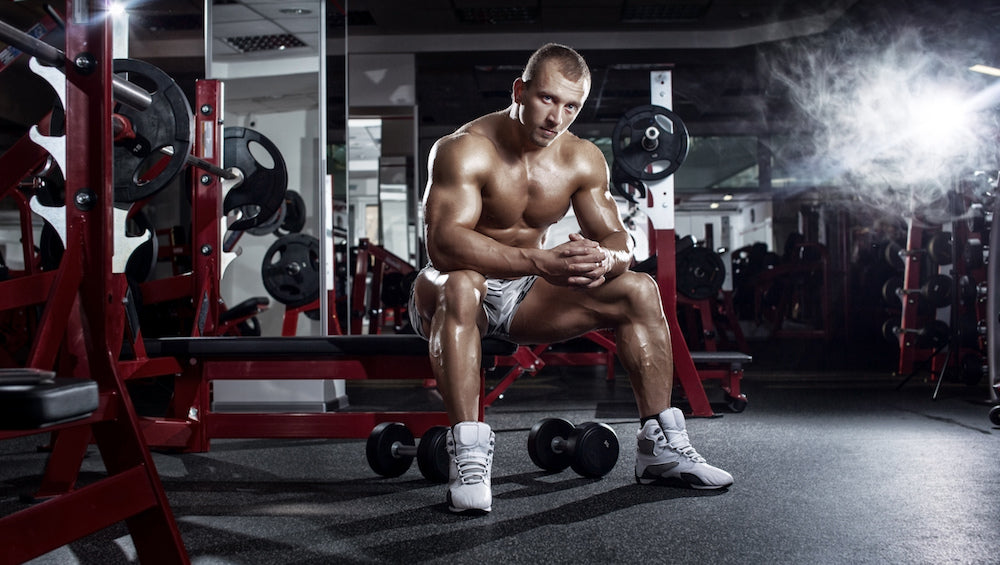 Body Builder resting on workout bench