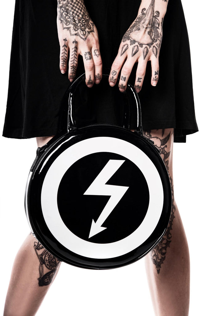 Model holding Marilyn Manson shock symbol Full Of Venom Handbag from KILLSTAR