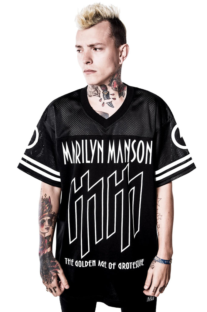 man in Ka-Boom Ka-Boom Hockey Jersey from Killstar x Marilyn Manson Clothing Line