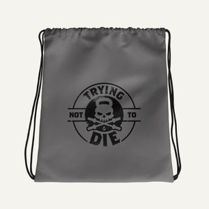 Trying Not To Die Drawstring Bag