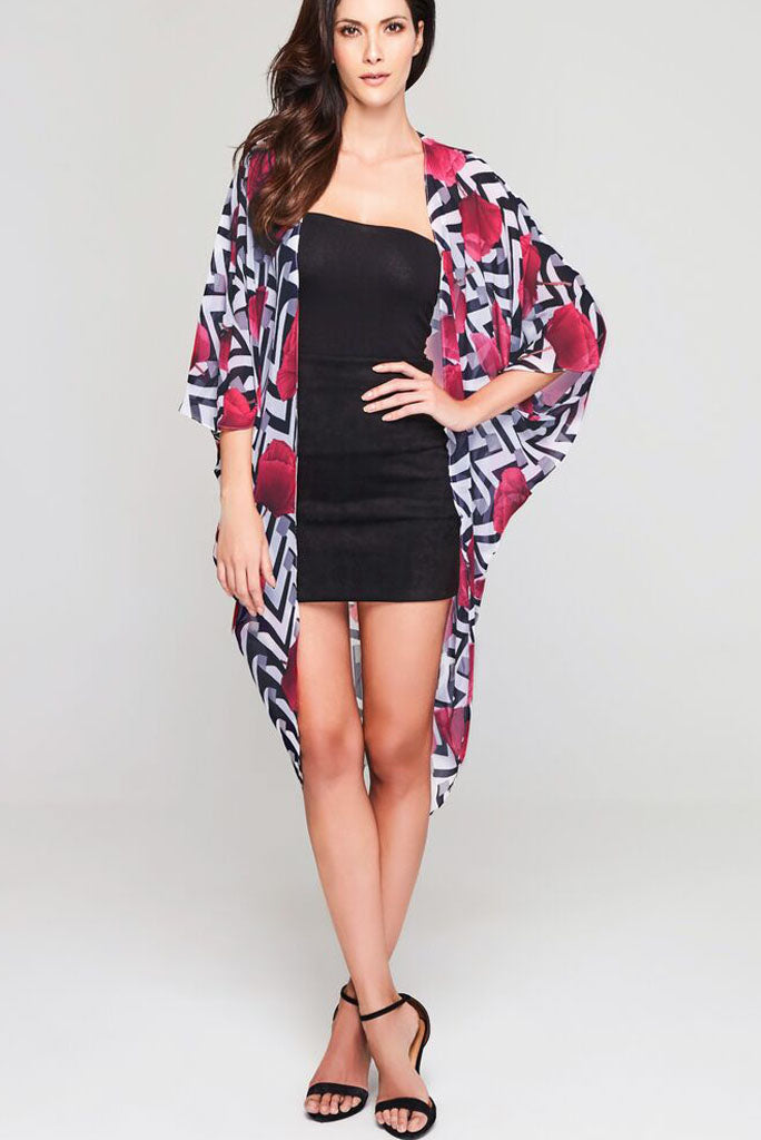 Model wearing chevron print kimono with poppy petals facing front