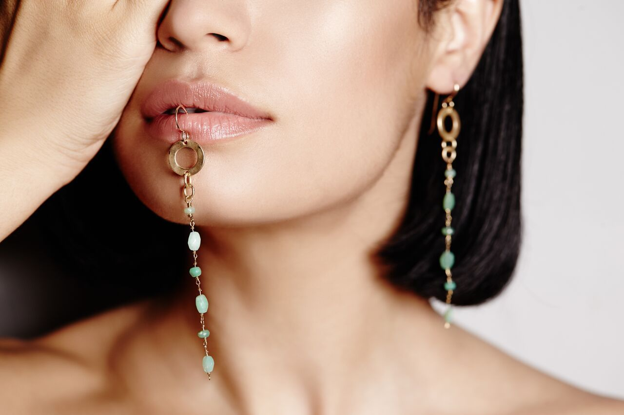 model wearing sparkling Chrysoprase gems streaming down