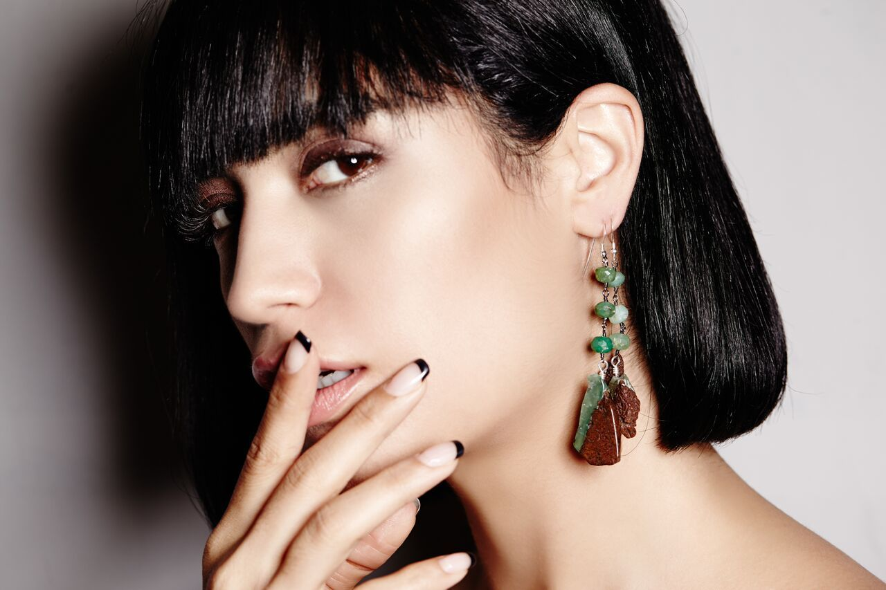model wearing Minty opalescent Chrysoprase cuts across hickory rocks, with matching Chrysoprase orbs. earrings