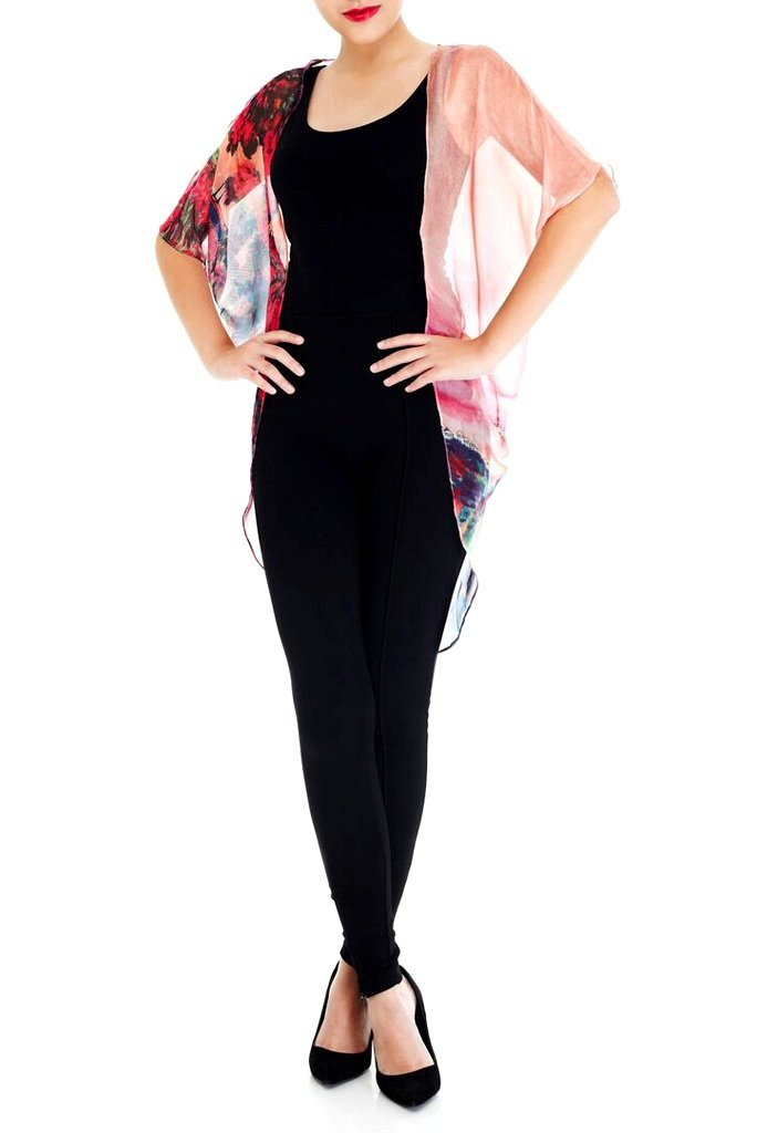 Model wearing short pink kimono with striking ombre prints facing front