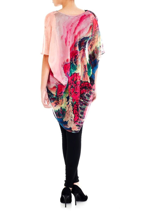 Model wearing short pink kimono with striking ombre print