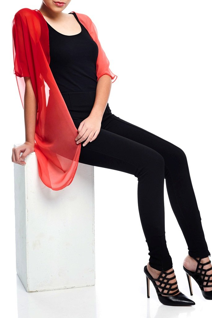 Model wearing short red ombre chiffon kimono seated down