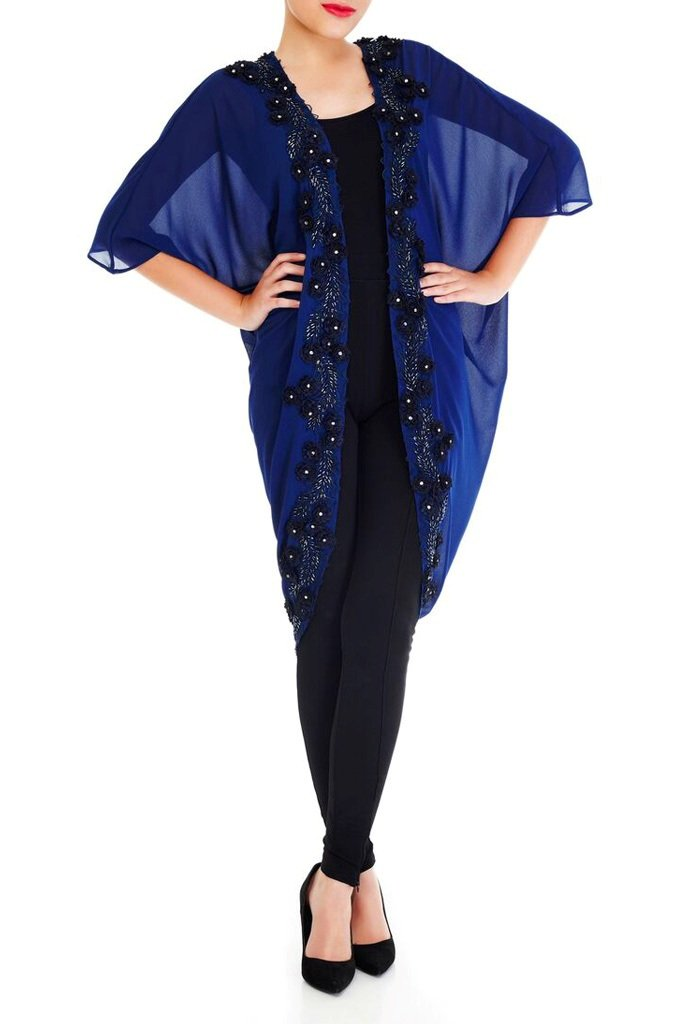 Model wearing navy blue kimono with twilight blue floral border and gemstones