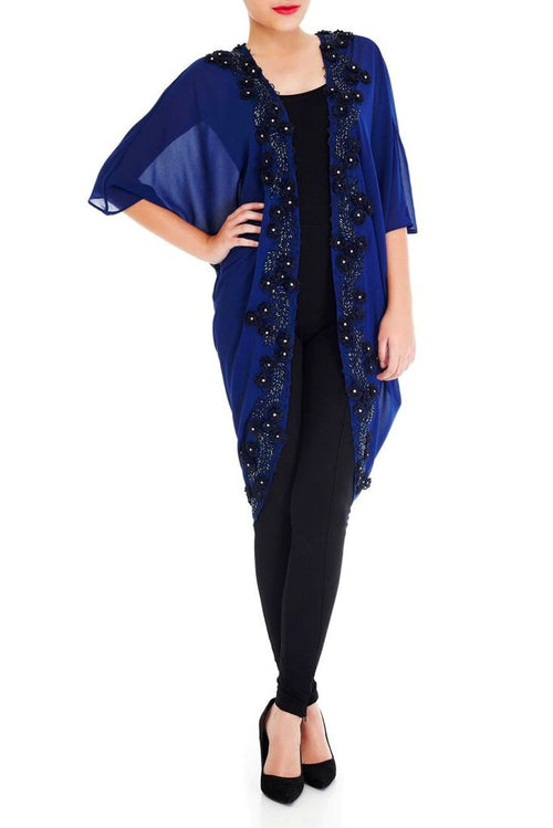 Model wearing Navy blue kimono with a floral border in twilight blue and gemstones.