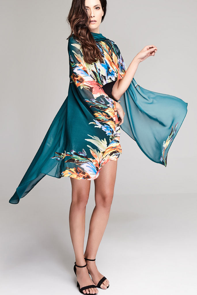 Model wearing green throw with floral prints