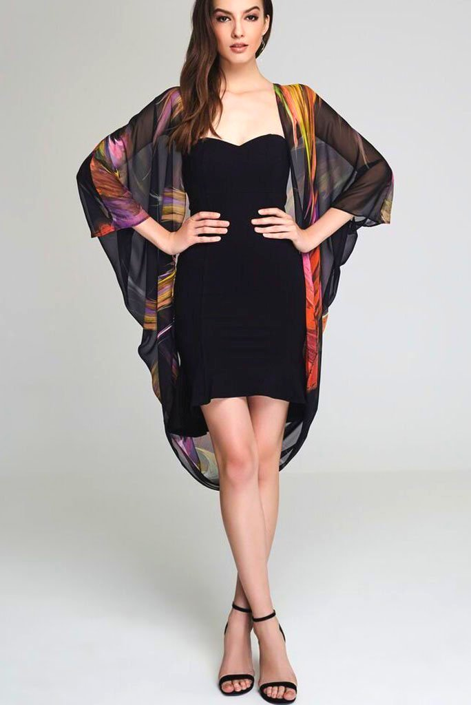 Model wearing black kimono with splashes of color front facing