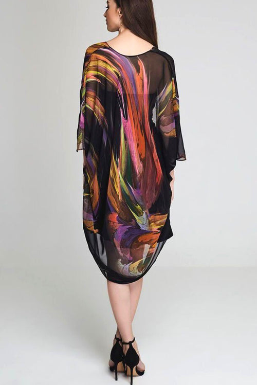 Model wearing black kimono with splashes of color facing backward