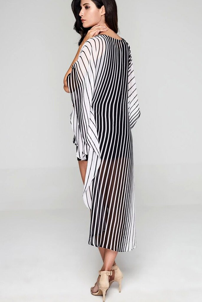 Model wearing monochrome dress with flattering stripes facing sideways