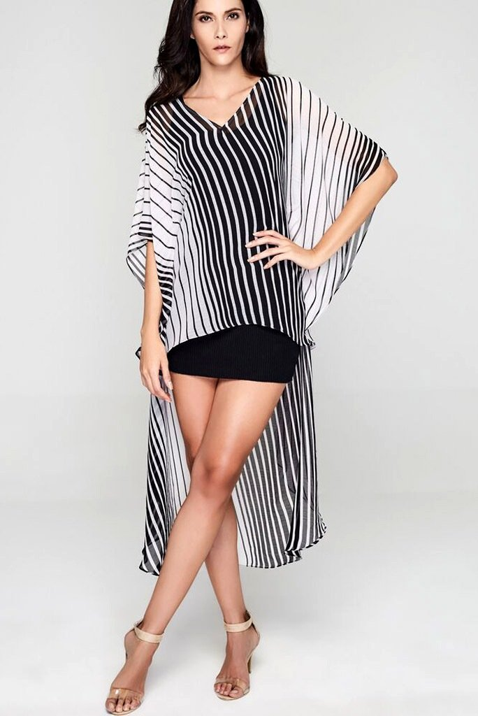 Model wearing monochrome dress with flattering stripes facing forward
