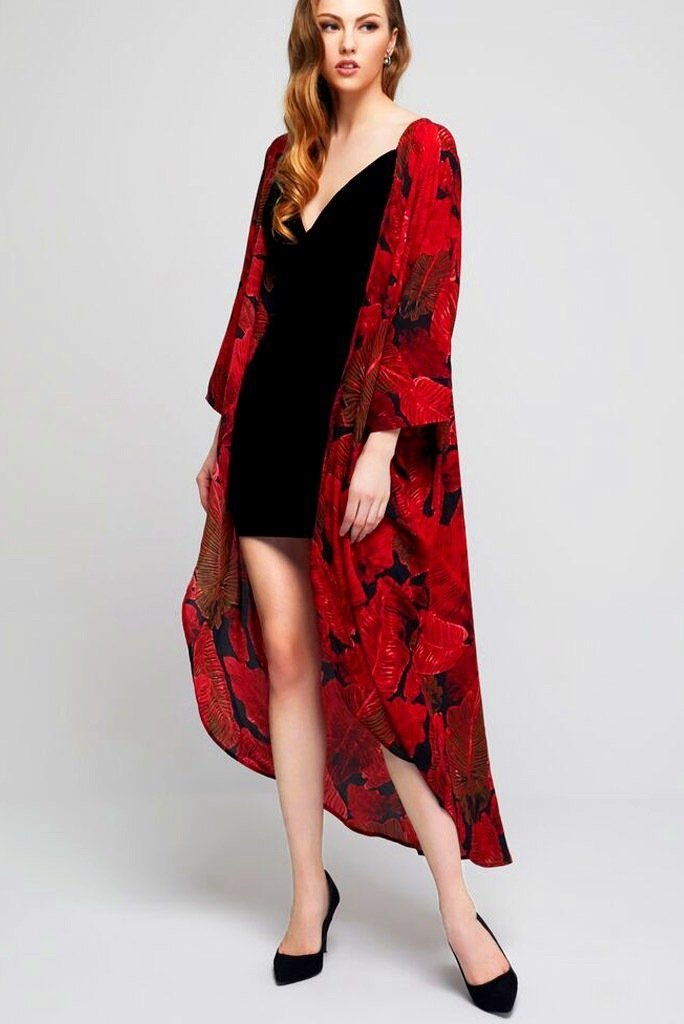 Model wearing long black crepe kimono with red leaf prints facing front