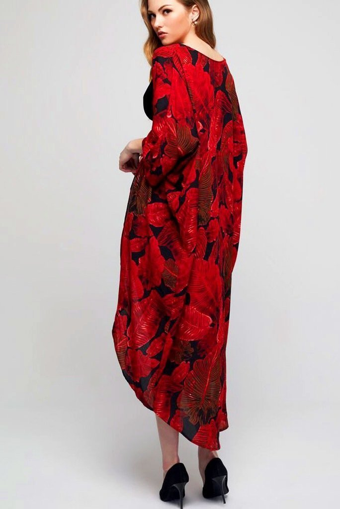 Model wearing long black crepe kimono with red leaf prints facing back