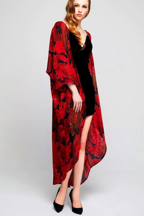 Model wearing long black crepe kimono with red leaf prints