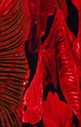 black crepe fabric with red leaf prints