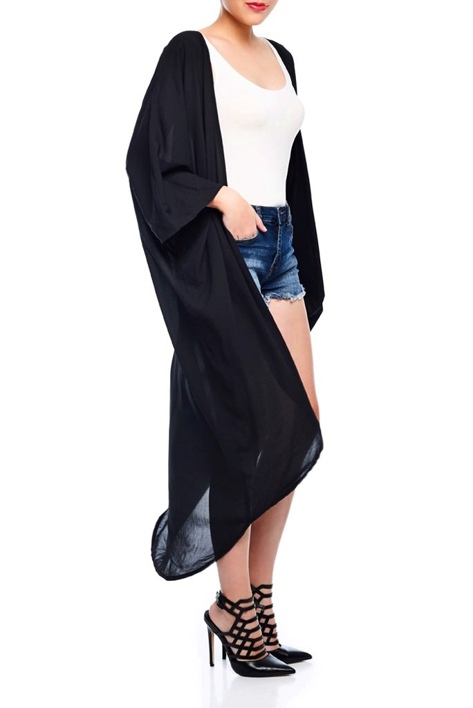 Model wearing long jet black kimono facing sideways