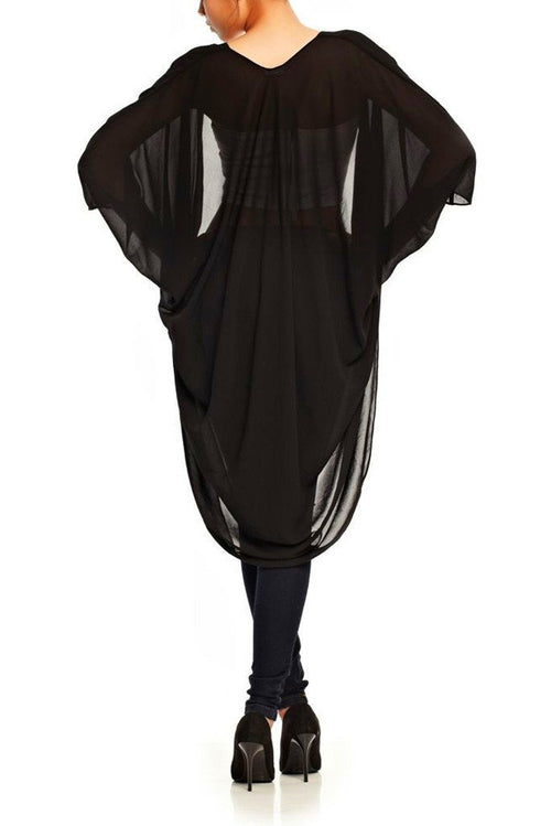 Model wearing black chiffon kimono facing back