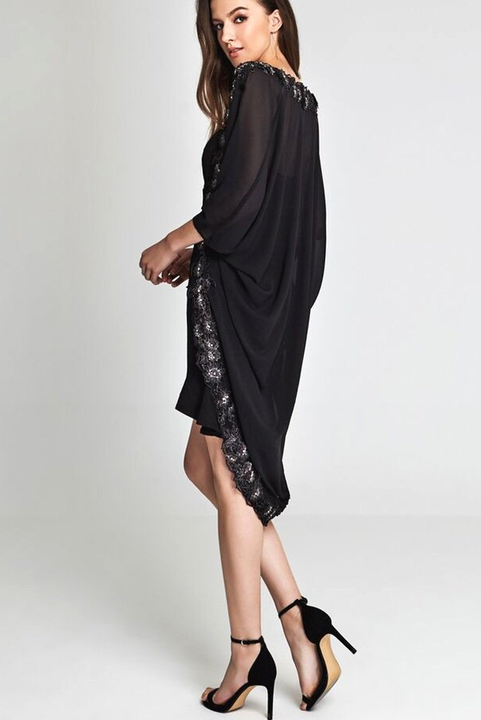 Model wearing black kimono with a floral embellish & gem stones facing sideways
