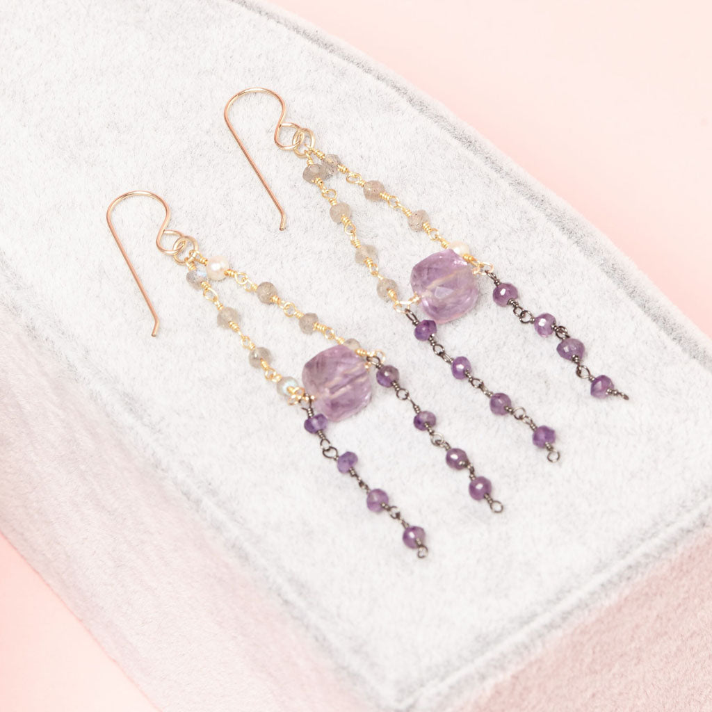 glowing amethyst and cascading dainty gemstone beads.