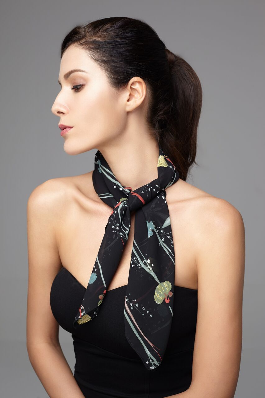 Model wearing black scarf with petite floral prints