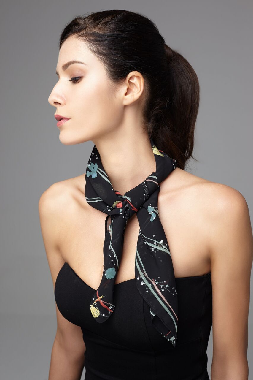 Model wears black scarf with petite floral prints