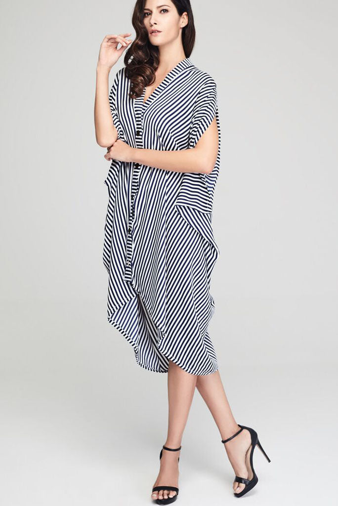 Model wearing blue and white striped drape dress facing forward
