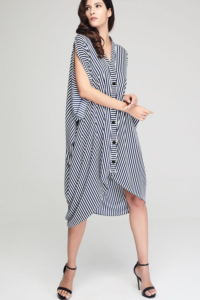 Model wearing blue and white striped drape dress front shot