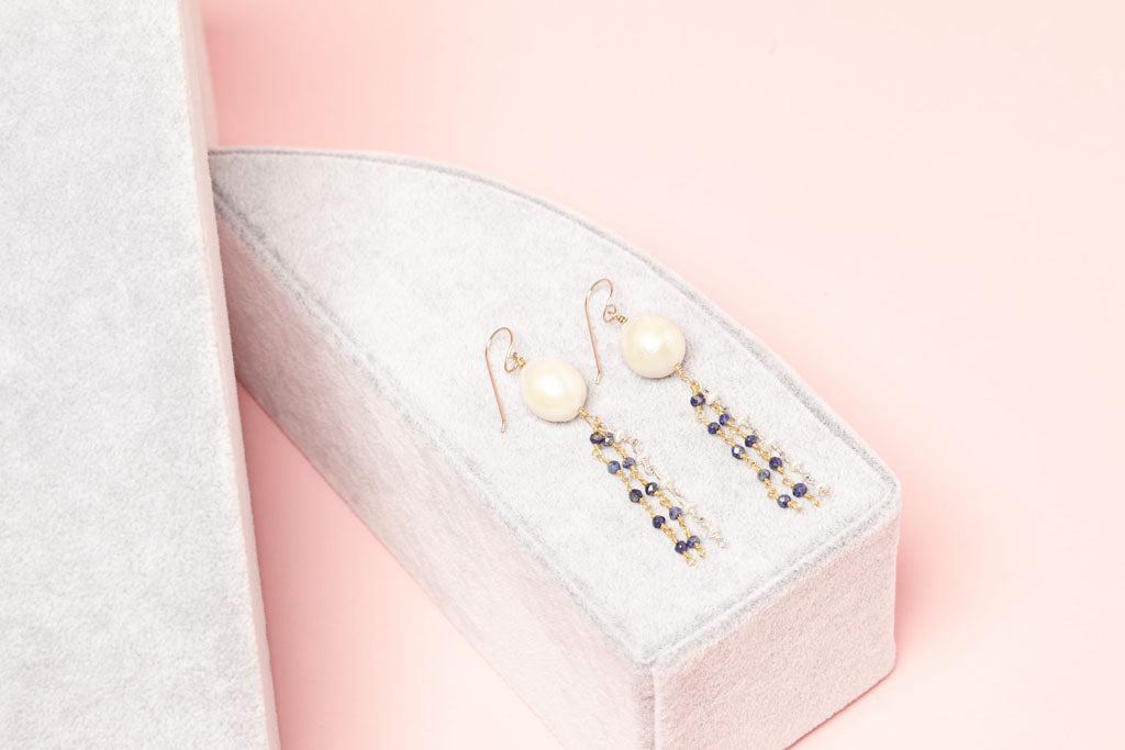 Dazzling white pearls with blue and white gemstone beads earrings on box