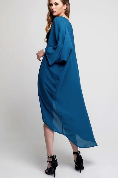 Model wearing long teal crepe kimono facing back