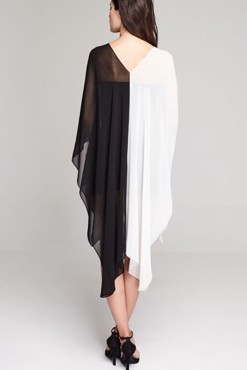 Model wearing black & white chiffon hi-lo dress facing backwards