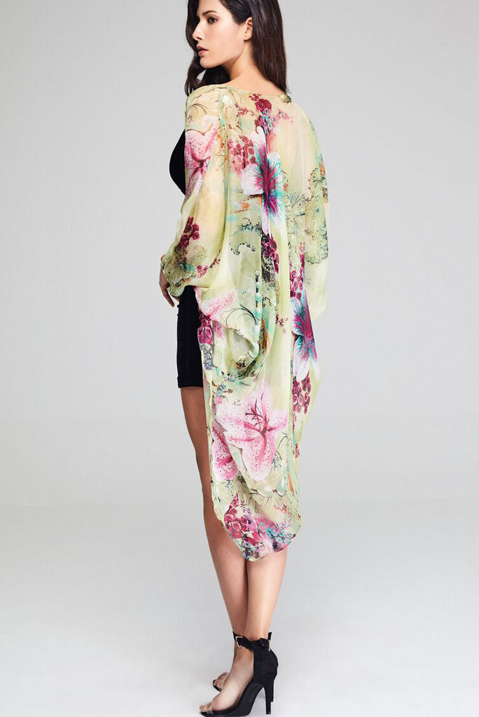 Model wearing silk kimono with floral prints facing back