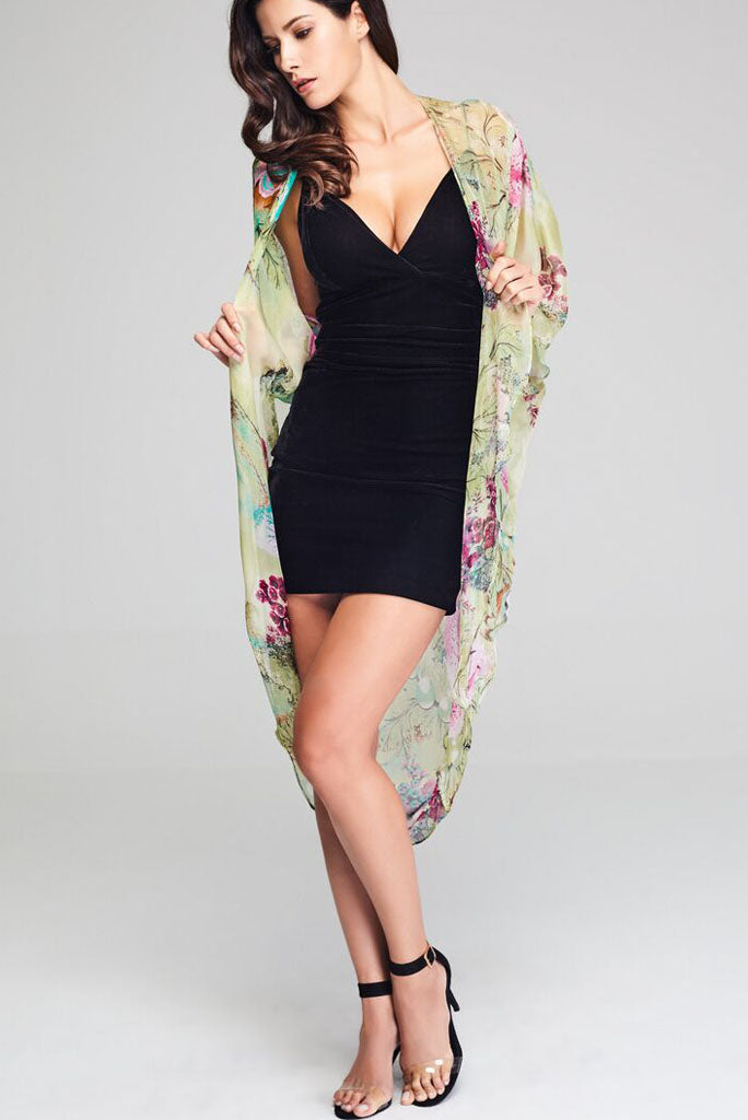 Model wearing silk kimono with floral prints facing front