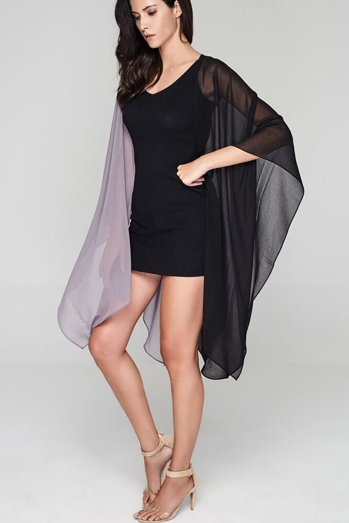 Model wearing black & grey throw facing sideways