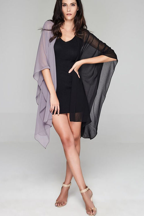 Model wearing black & grey throw facing forward