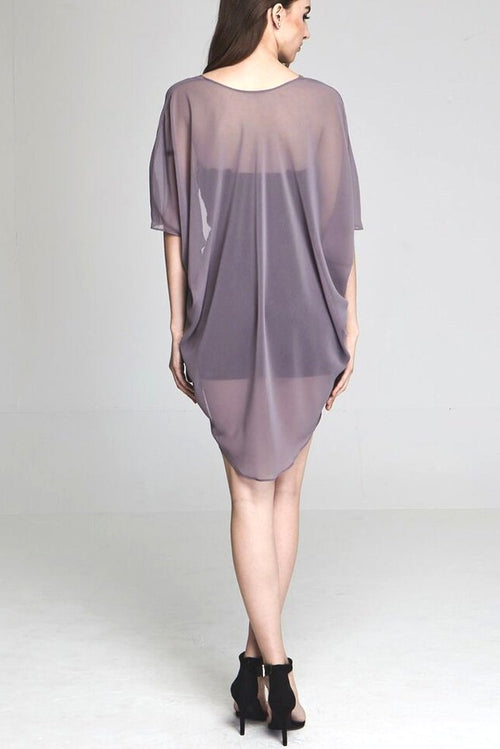 Model wearing short grey chiffon kimono facing back